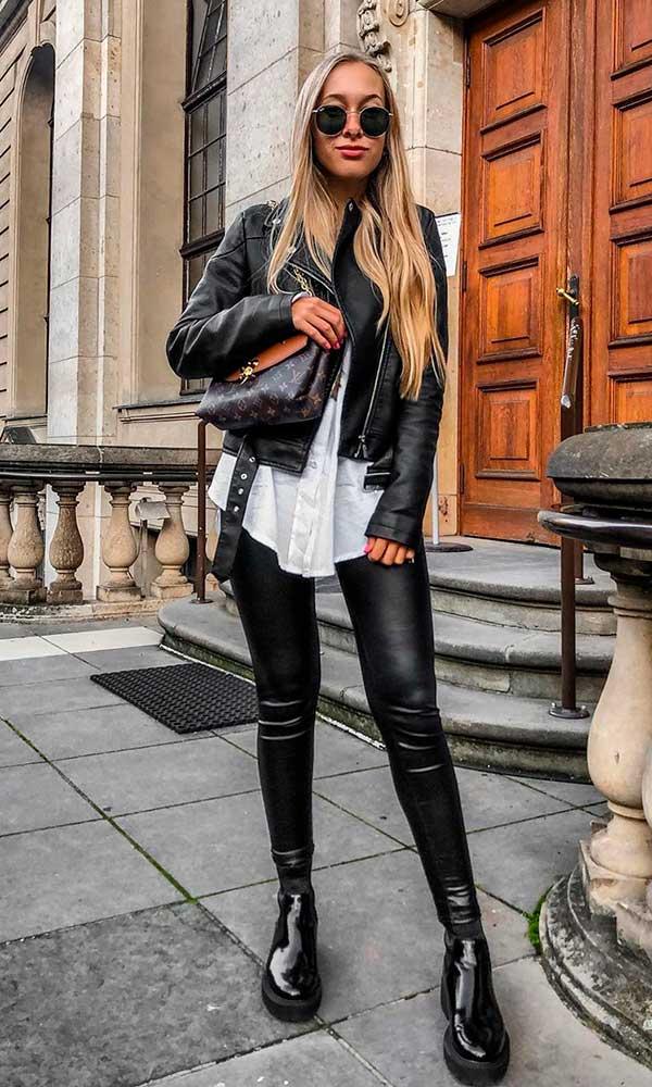 jaqueta e calça de couro e coturno