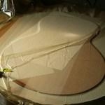 Mahogany veneer being glued to back