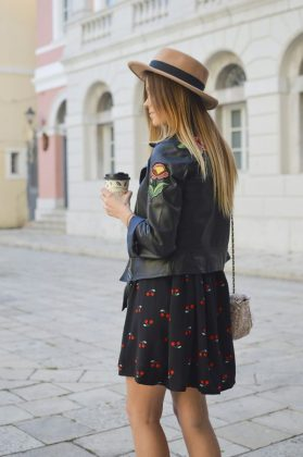 Girl in floral dress with black leather jacket