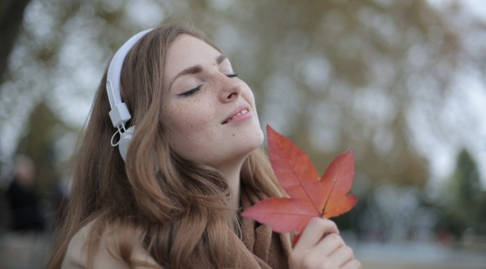girl with headphones for fall playlist