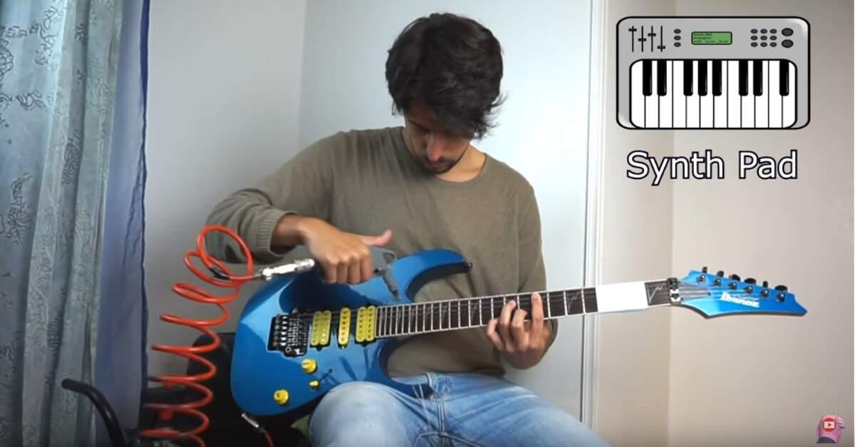 Homem tocando guitarra com ar comprimido