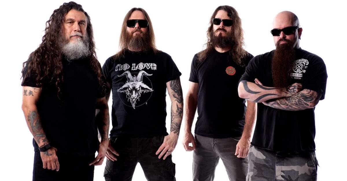 Membros do Slayer posando para foto
