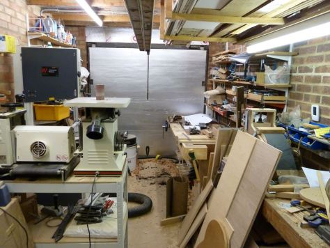 Jigsaw, drum sander and vertical oscillating sander opposite new bench