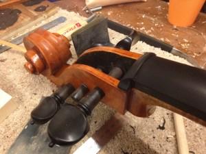 Nut glued onto end of fingerboard