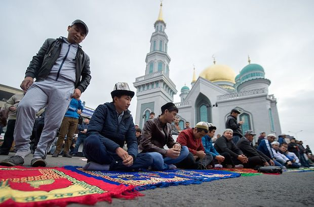 Muslims attend a morning prayer to mark Eid al-Adha in Moscow.
