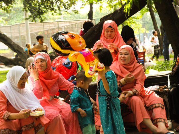 Muslim women with the same colors of Hijab, exchange conversations during the Eid Al Adha celebrations in Quirino Grandstand grounds in the Philippines.