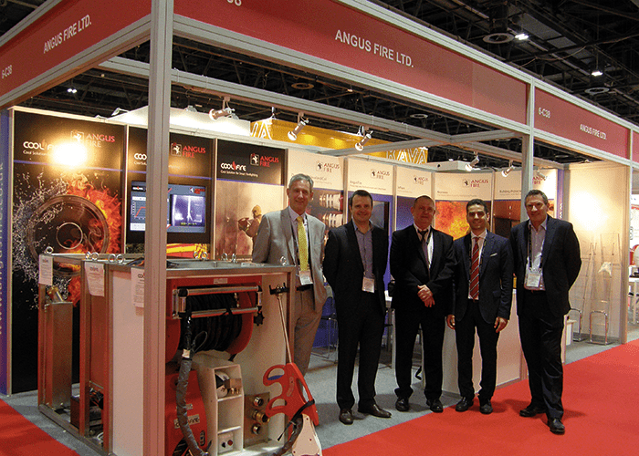 Angus Fire management team at Intersec next to the CoolFire skid.