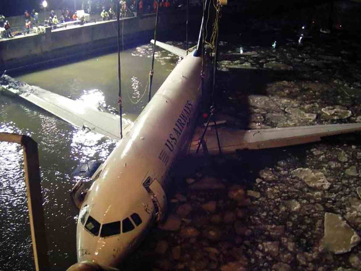 US Airways Flight # 1549 being removed from the water by crane.