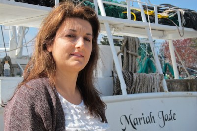 Kim Chauvin beside on of the family fishing boats.