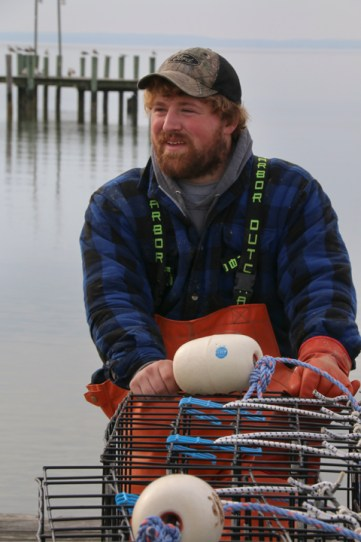 """""""It gets to be a little cold out there on the water this time of year,"""" said Ethan Davis who comes from as an historic Chesapeake waterman family as it gets; working the Bay's water for more than five generations. Photo: Ed Lallo/Newsroom Ink"""