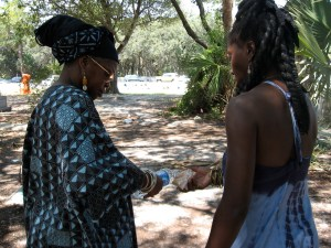 Queen Quet and Elder Carlie Towne conduct libation ceremony