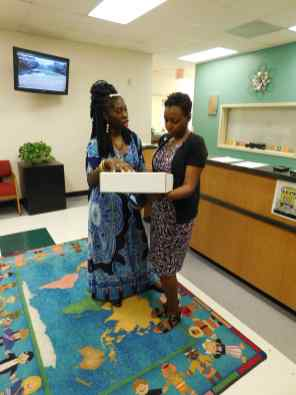 Queen Quet presents Principal Mack with EarthEcho Challenge kit.