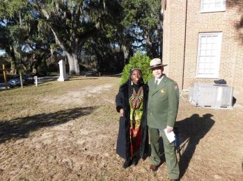 """Queen Quet, Chieftess of the Gullah/Geechee Nation and NPS Director Jonathan Jarvis at Brick Baptist Church on historic St. Helena Island, SC in the Gullah/Geechee Nation. Brick Baptist Church is one of the sites of the """"Reconstruction National Monument."""""""