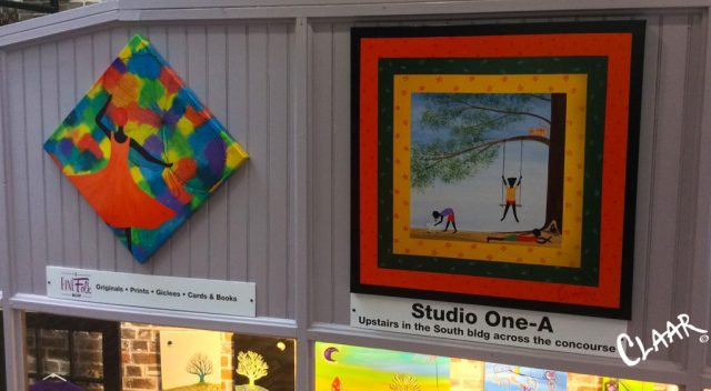 3ft.-Square-enhanced-giclee-of-'Yard-Happiness'--on-display-above-Keller's-Abstract-Art-in-City-Market