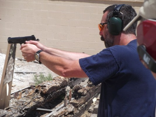 Gun Guy demonstrating proper grip for a student.
