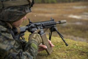 U.S. soldier firing a rifle