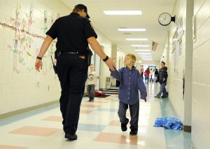 School resource officer gives a kid a high five