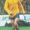 Geordie in a classic Arsenal away kit