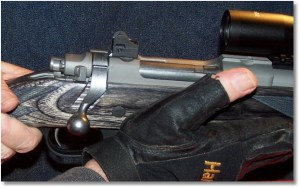When lock-up is felt, the base of the thumb pushes the bolt handle downward to complete the lock up of the bolt and then moves forward to its support position on the forearm of the rifle.