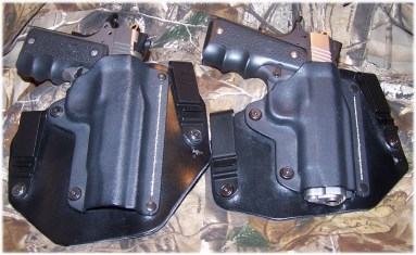 "SR1911CMD (Left) in Black Arch ""Government"" Holster.  SR1911CMD-A (Right) in a Black Arch ""Commander"" Holster."