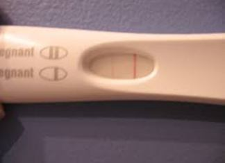 faint pink line and dark line in pregnancy test in hindi