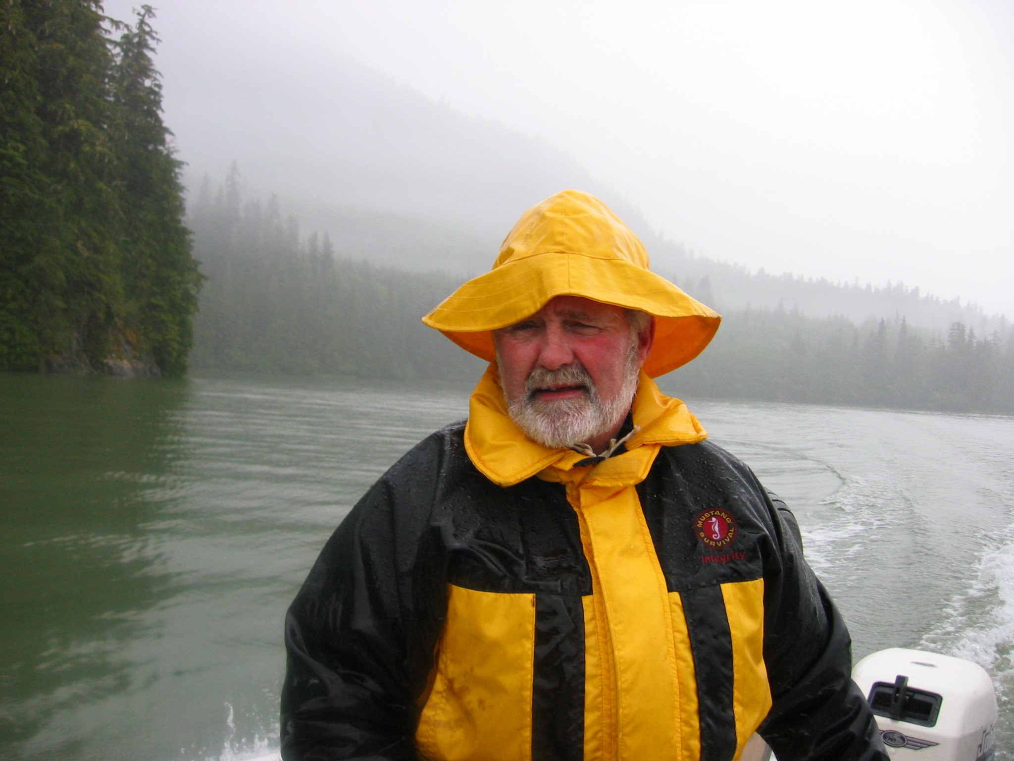 Rain and fog, rain and fog, a soggy Captain heads out to check crab traps early in the morning before the winds come up to rage and blow the channel clear.