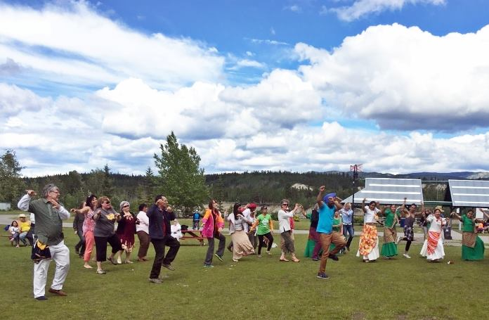 Yukon MP Larry Bagnell, Leader of Opposition and NDP Leader Elizabeth Hanson, Liberal candidate Tamara Goeppel, Yukon Cares Founder Raquel De Queiroz, Whitehorse City Councillor Jocelyn Curteanu, Members of Filipino Group, and many others dance Bhangra on multicultural day led by Gurdeep Pandher