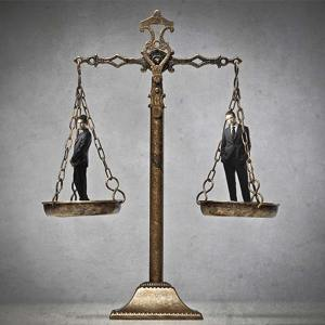 Legal accountants stand on justice scales