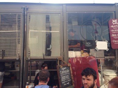 I enjoy that this food truck has massive glass windows on the side; the food is also really good.