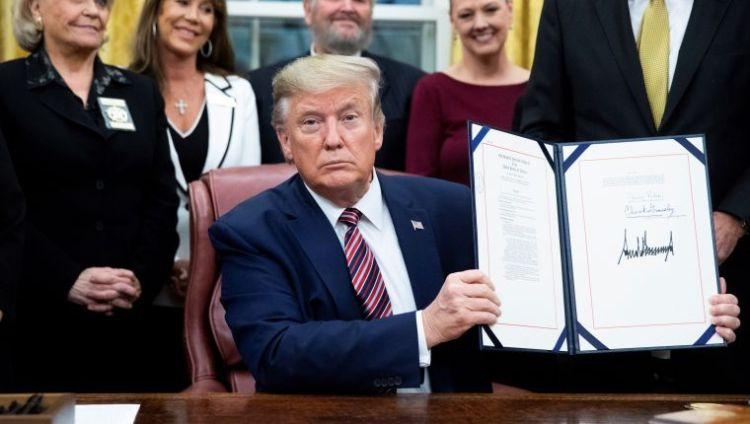 Donald Trump stamps his signature at Animal Cruelty and Torture Prevention Act