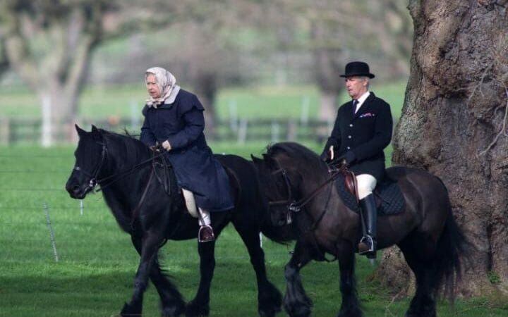 Queen Elizabeth II walking on her horses
