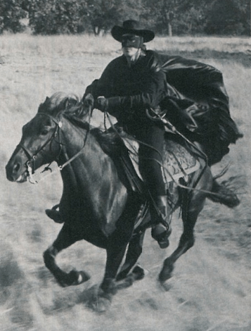 "Buddy Van Horn riding Ribbon his favorite ""Tornado"""