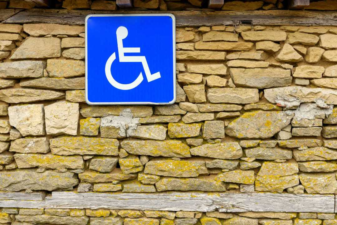 Accessibility Traffic Sign on a stone wall