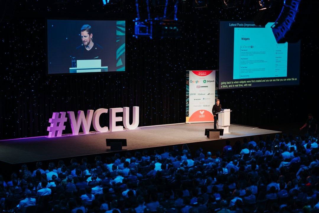 Photo from balcony onto Stage w/ Matt Mullenweg and big #WCEU sign