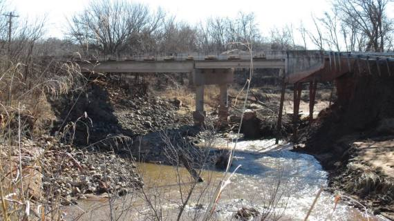 Four bids received to rebuild washed-out county bridge