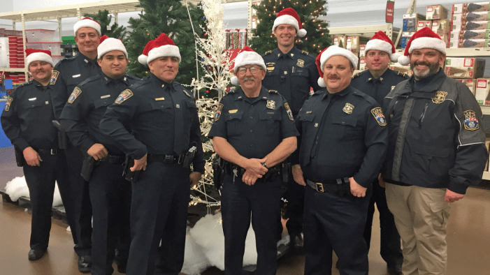 Guthrie police officers help children shop for Christmas