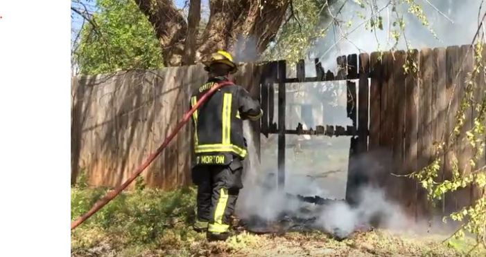 Video: Overnight burn pile catches residence fence on fire