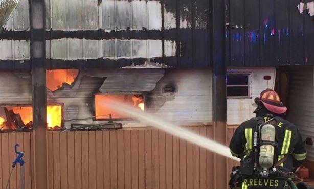 Smoke and flames over take trailer home