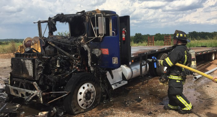 Video: Semi-truck destroyed by flames behind business