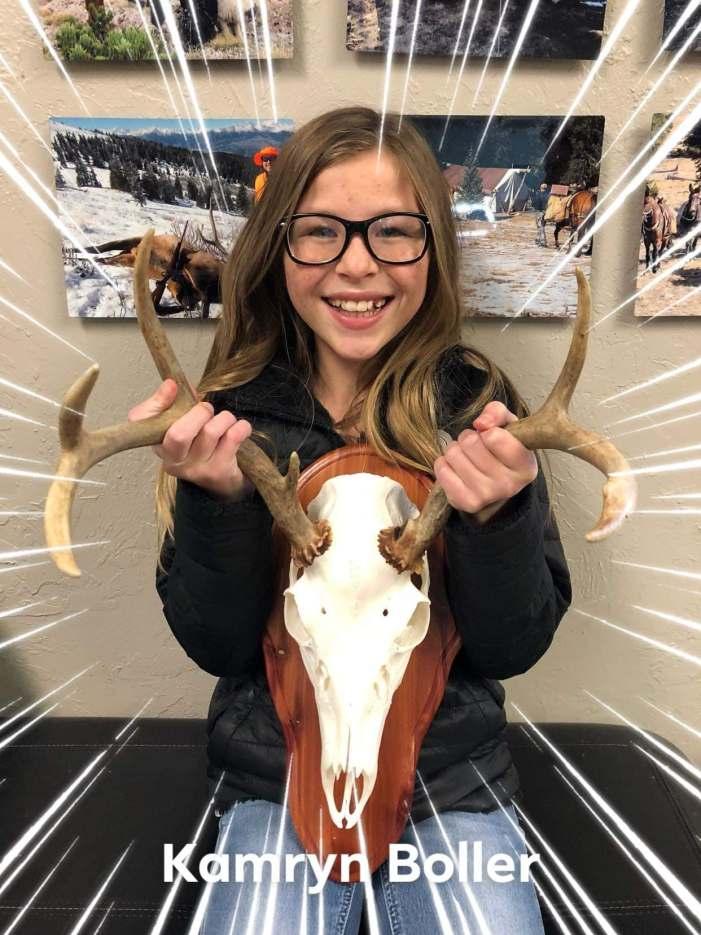 Kamryn Boller collects her first deer
