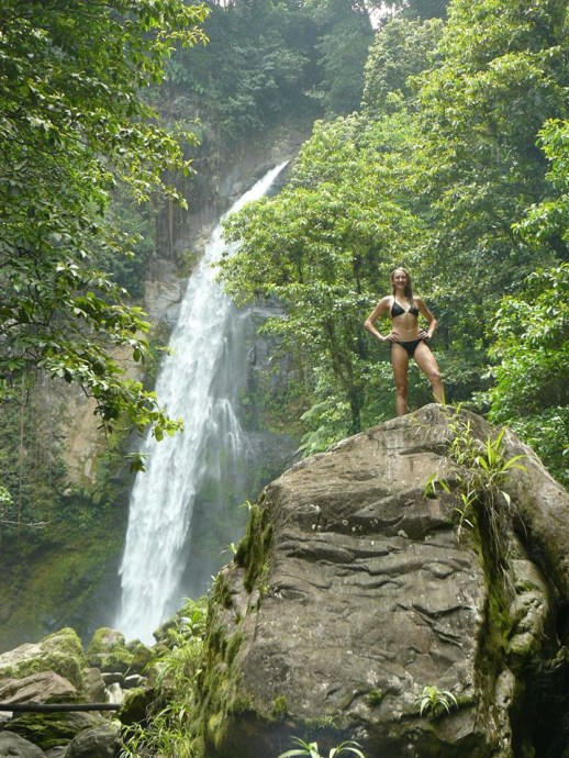 Pre-surgery me hiking with my family through the waterfalls in Dominica