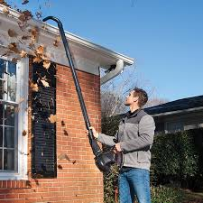 Blowing debris from your gutters creates more work