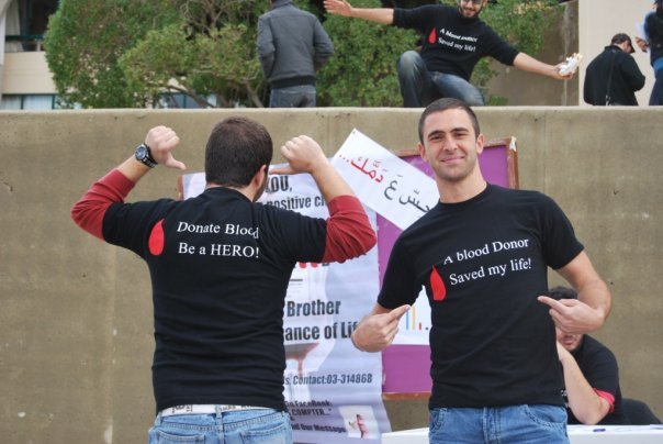 Yorgui (left) and his brother Marc raising awareness at Lebanon's Balamand University