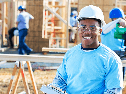 smiling young black construction worker