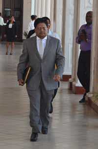 Finance Minister, Dr. Ashni Singh, makes his way to the Parliament Chamber, where he made his 2014 Budget presentation, three minutes shy of three hours, yesterday