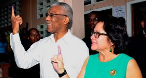 President David Granger and First Lady Sandra Granger showcase their inked index fingers after voting at the Enterprise Primary School, Durban Backlands
