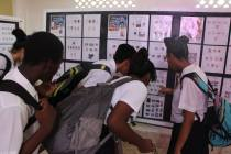 Students discussing GUYPEX 2016 Stamp displays