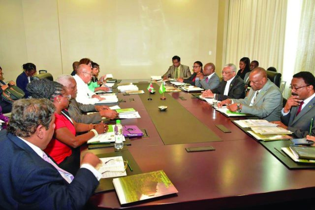 The Guyanese and Surinamese delegation led by President David Granger and President Désiré Delano Bouterse during a plenary session at the Marriott Hotel