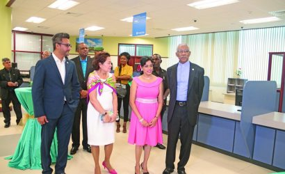 The President and First Lady on a tour of the new facilities at the Republic Bank, Triumph branch
