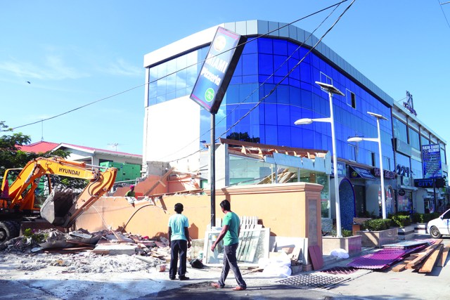 """M&CC workers tore down the """"illegal"""" extension on this Sheriff Street business on Thursday"""
